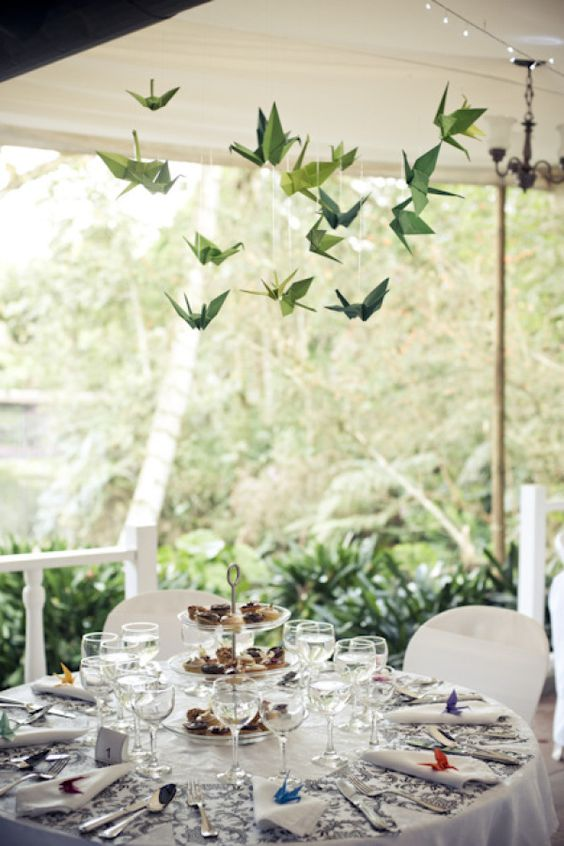green paper cranes hanging over the reception tables will add a quirky touch to the space