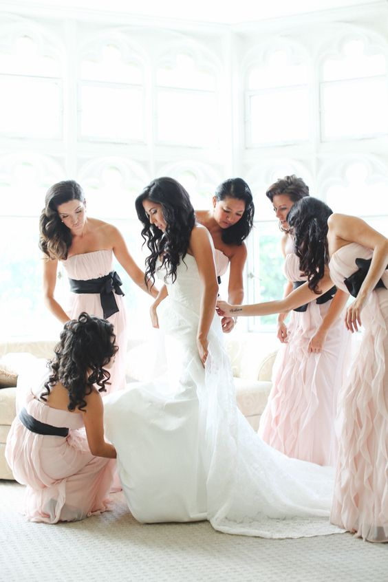 ruffled strapless bridesmaids' dresses with black sashes for a refined look