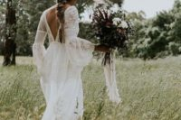 14 a boho lace wedding gown with bell sleeves, a cutout back and a train