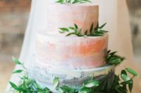 14 a watercolor coral and blue wedding cake with ombre effects and fresh greenery