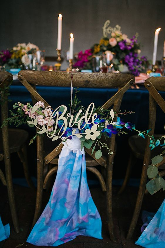 bold watercolor turquoise and pink chair posies with calligraphy and fresh blooms