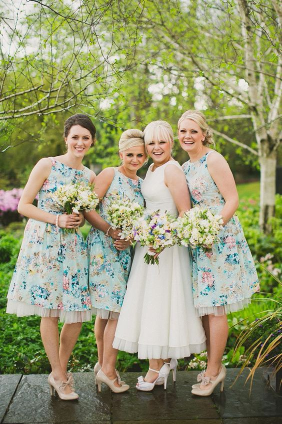 4b12a2d4f9a2 halter neckline knee blue bridesmaids' dresses with floral prints and tulle  underskirts for a retro