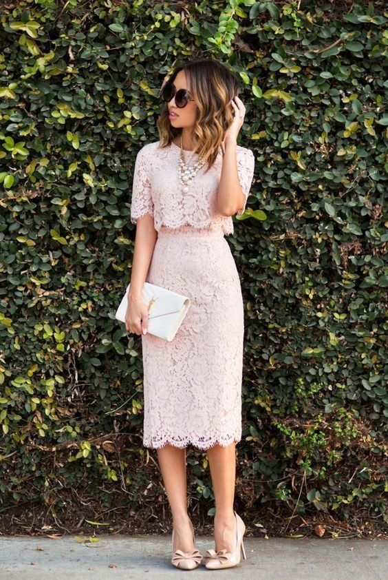 a nude lace top and midi skirt plus a statement pearl necklace and blush shoes, a small white clutch