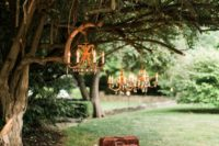 15 a vitnage picnic setting with a lot of pillows, glam chandeliers and some vintage items instead of a sweetheart table