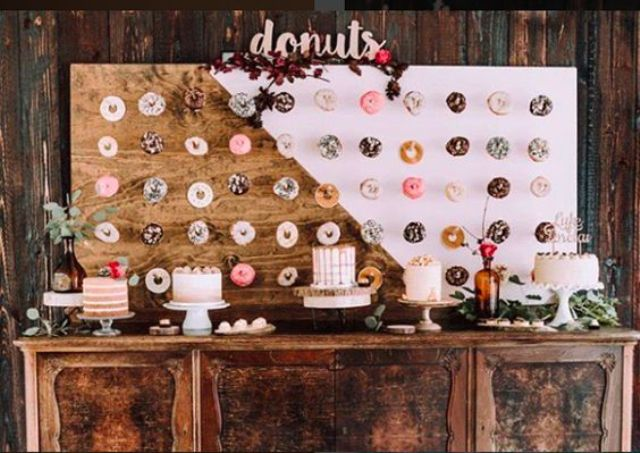 color block painted donut wall with calligraphy and some blooms on top