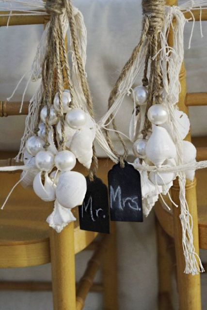 shells and oversized pearls on ropes with chalkboard tags are great for a pirate wedding