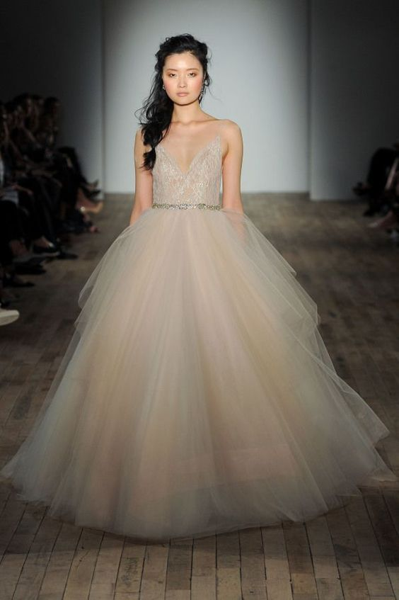 a champagne wedding ballgown with an embellished sparkling bodice on straps and a layered full skirt by Lazaro