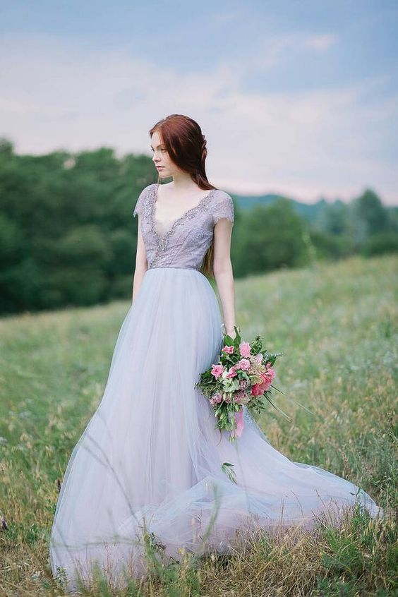 a lavender wedding gown with a lace embellished bodice, a V-neckline and a layered skirt