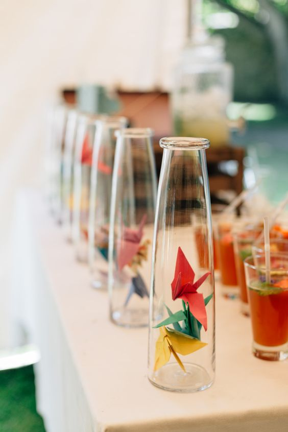 bottles with colorful paper cranes for decorating a drink bar or a station at your wedding