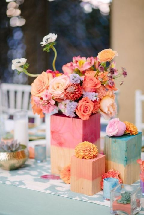 watercolor wooden blocks covering the vases with flowers and as stands
