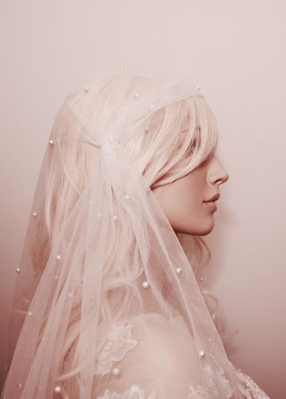 a pearl Juliet cap veil is a modern take on traditional pearl wearing at weddings