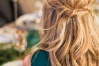18 a messy twisted wavy half updo on long hair is a great relaxed idea