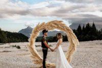 18 a pampas grass circle floral wedding arch for an ocean wedding