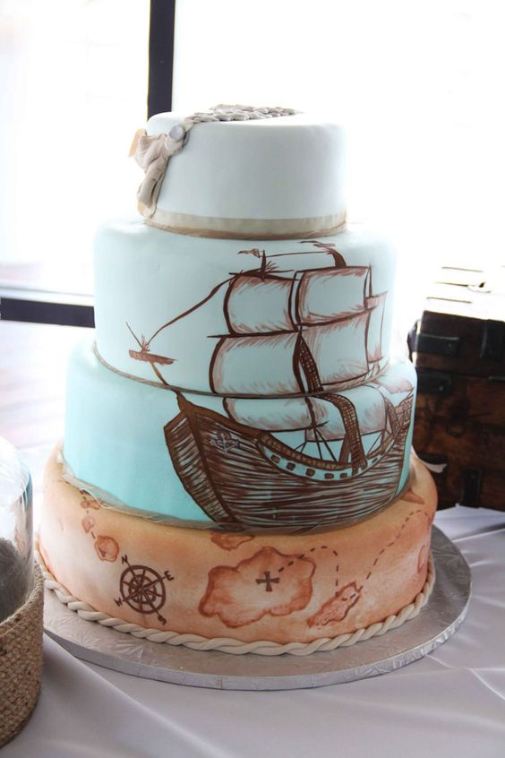 a wedding with a hand painted ship and map plus a rope on it
