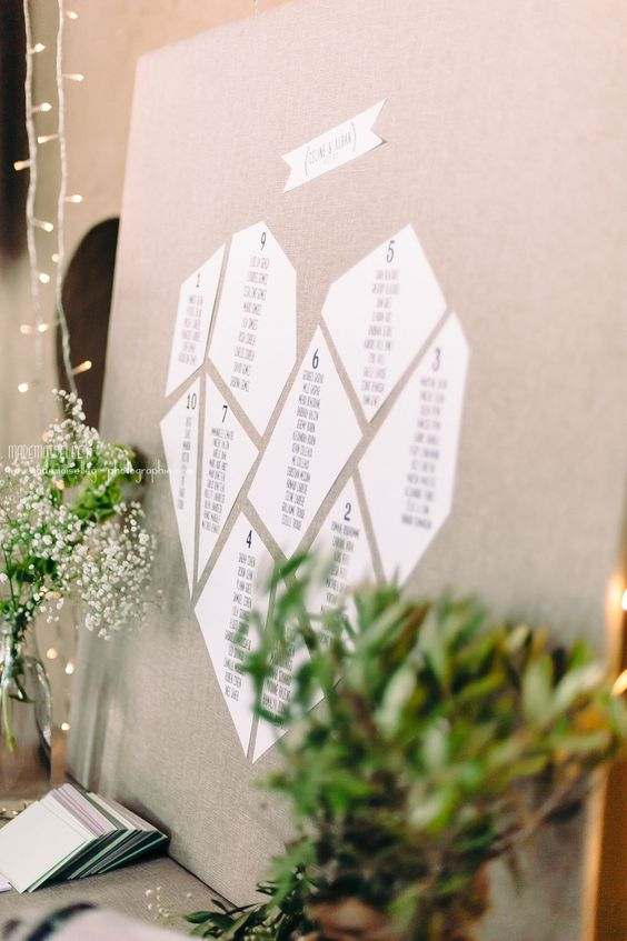 an origami-inspired heart seating chart is a trendy solution