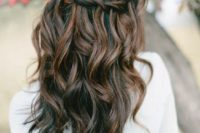 19 a chic twisted halo wavy half updo looks especially interesting with balayage