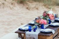 19 a nautical picnic setting with a striped runner, bold florals and candles looks very romantic and cute