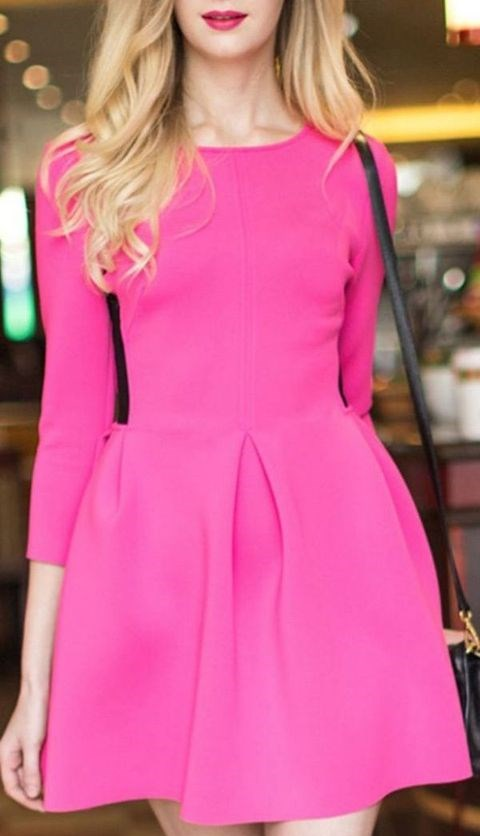 a hot pink mini dress with a high neckline, long sleeves, and a black bag