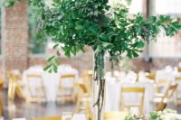 20 a natural greenery wedding centerpiece in a tall vase and a matching greenery runner