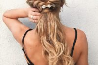 20 a twisted braided half up ponytail accented with a geometric hairpiece