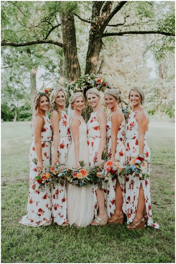 halter neckline maxi dress with side slits and red floral prints for a relaxed wedding