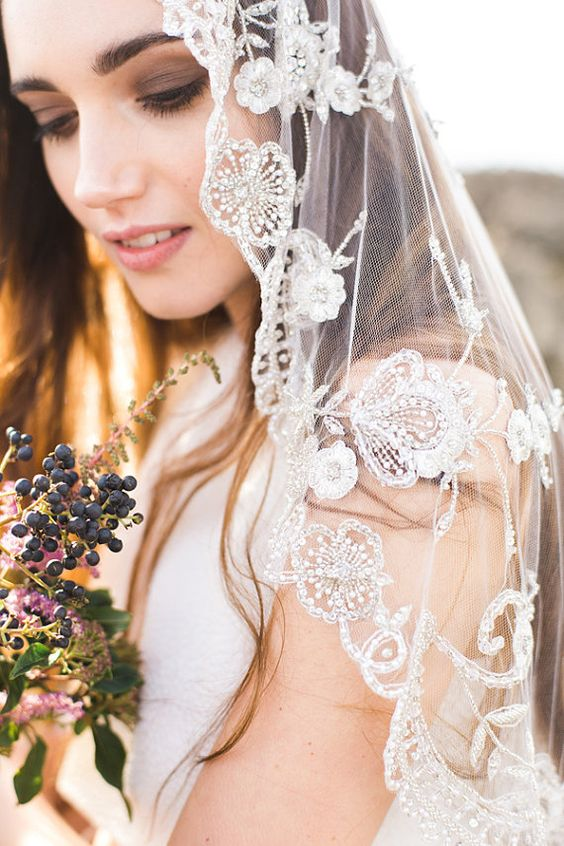 a beaded and embroidered wedding veil is a very beautiful and romantic accessory