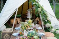 21 a boho picnic setting with Moroccan ottomans, an embroidered table runner, colorful wildflowers and herbs and pampas grass