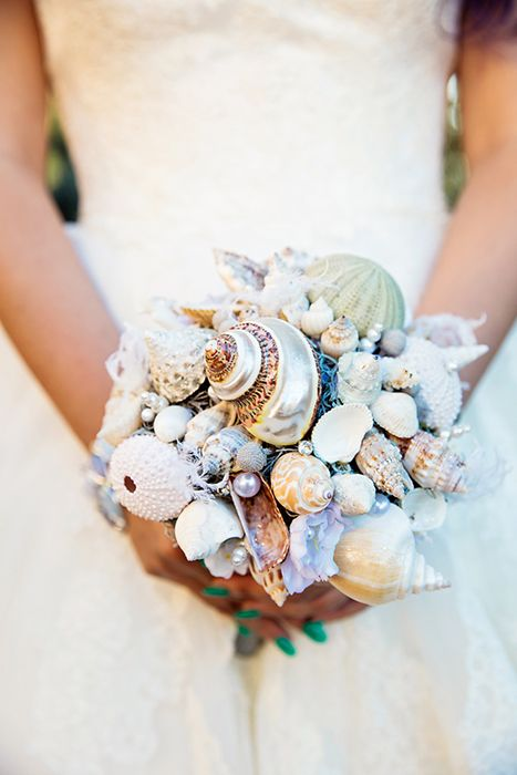 a bridal bouquet made of shells, sea urchins and pearls completely, no blooms