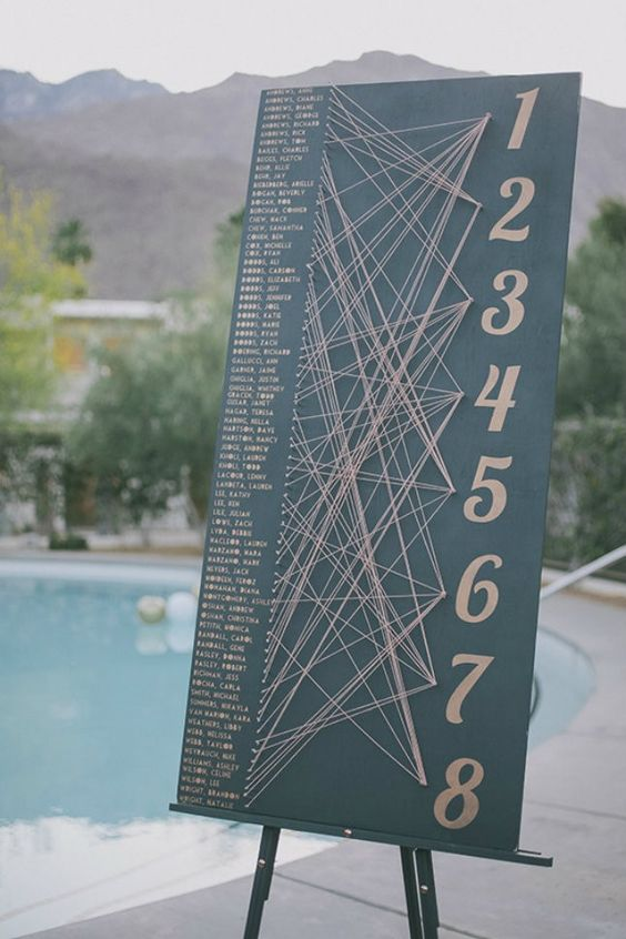 a creative string art seating chart is a fun solution and your guests will play this game with pleasure