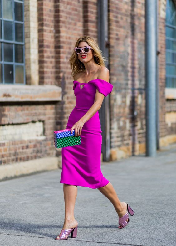 a hot pink off the shoulder dress with a playful neckline, pink metallic shoes and a colorful clutch