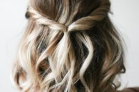 21 a simple twisted updo with waves and some volume is great for relaxed weddings