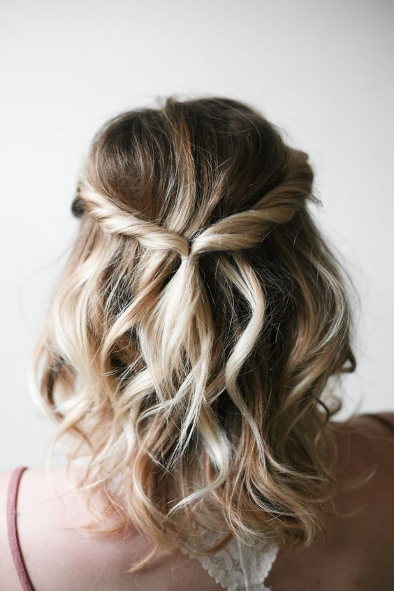 a simple twisted updo with waves and some volume is great for relaxed weddings
