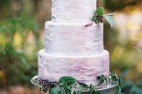 21 a watercolor lavender wedding cake topped with some berries for a boho or woodland wedding
