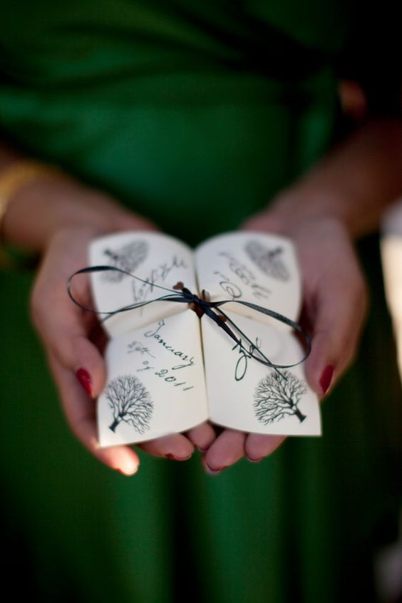 origami wedding program with a black ribbon bow for a fun feel