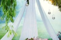 22 a dreamy and romantic picnic setting with a teepee with candle holders and a Moroccan-styled chest as a table