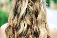 22 a fun half updo with waves and a bow of hair for those who want a playful look