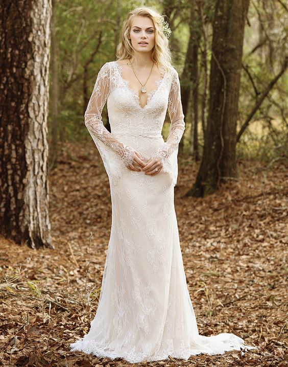 a lace wedding gown with a V-neckline, bell sleeves and a highlighted waist