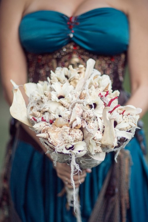 a shell bridal bouquet with corals is a unique statement