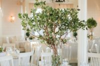 22 a simple yet stunning centerpiece with fresh greenery on branches is great idea for any season