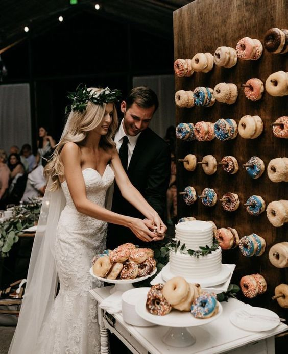 a wooden donut wall with donuts with various glazing