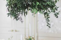 23 a tall eucalyptus centerpiece on a gilded frame to save some table space