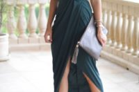 24 a draped dark green maxi dress with spaghetti straps, a wrap skirt with a slit, nude shoes and matching tassel earrings
