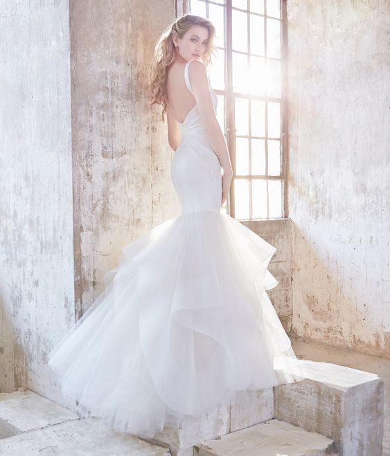 a mermaid strap wedding dress with a layered tail and an open back by Hayley Paige