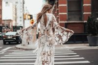 24 a sheer and boho lace applique wedding dress with bell sleeves and a cutout back