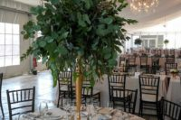 24 a tall foliage centerpiece with myrtle, seeded and silver dollar eucalyptus in a brass vase