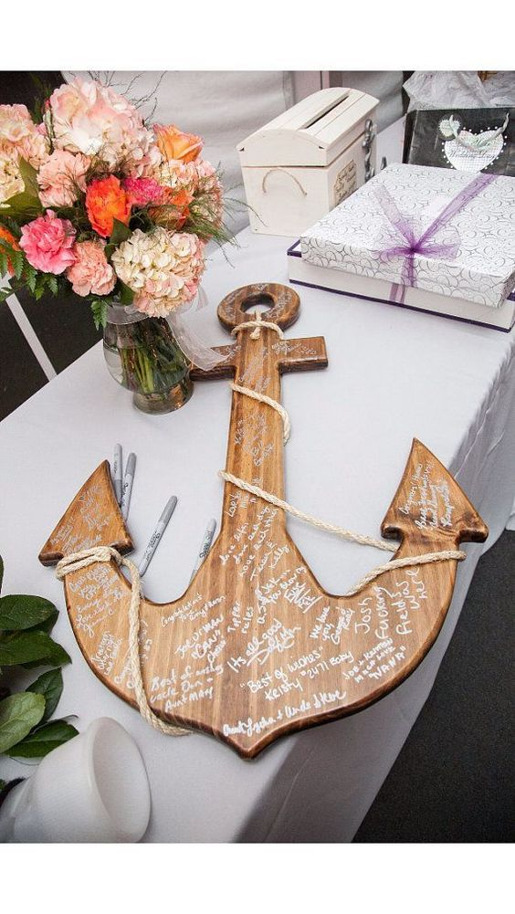 a wooden anchor is another great choice for an interesting guestbook