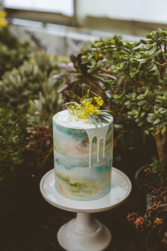 abstract watercolor wedding cake in pastel shades plus yellow sugar shards on top
