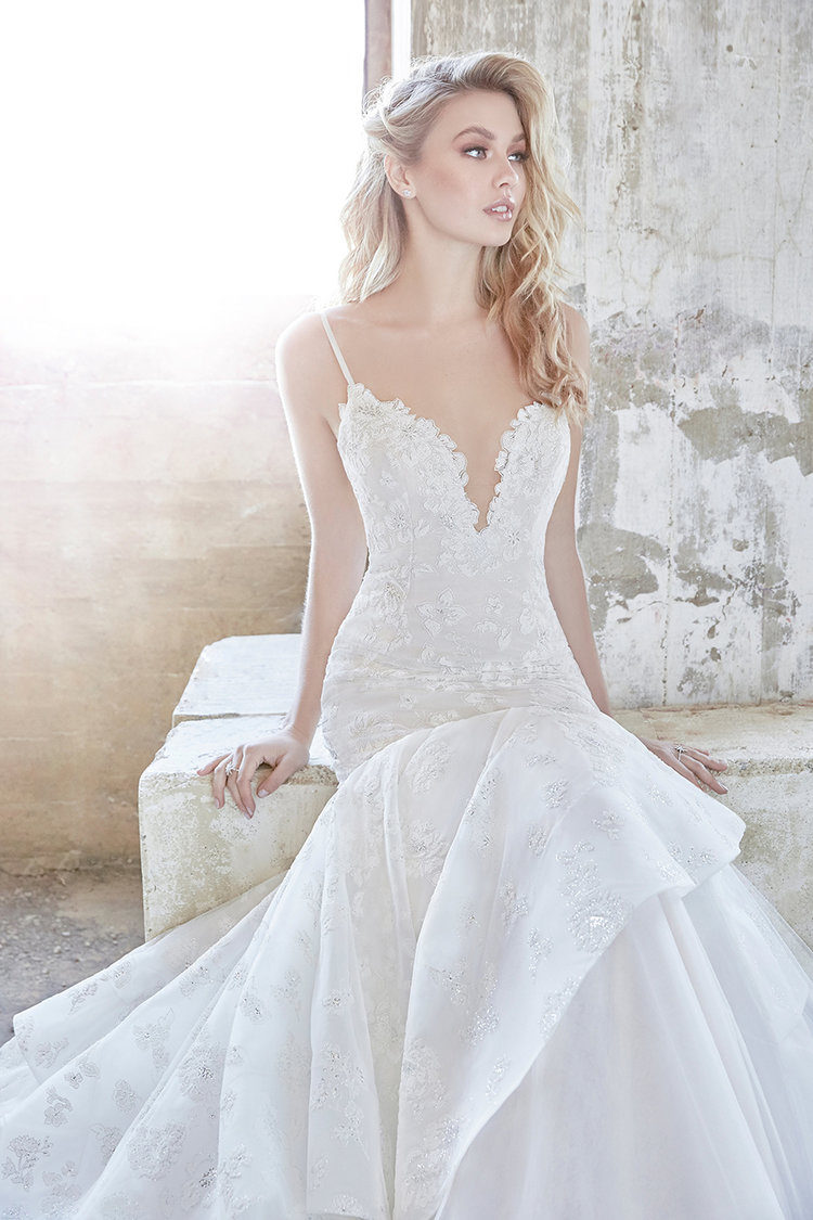 a mermaid wedding gown with spaghetti straps, a lace plunging neckline, lace appliques and embellishments by Hayley Paige