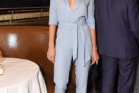 25 a powder blue jumpsuit with a sash, half sleeves and black heels are an elegant solution