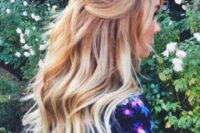 25 a simple half up half down hairstyle with waves is a classic and timeless option